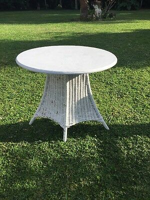 Antique Wicker Table With The Wooden Top