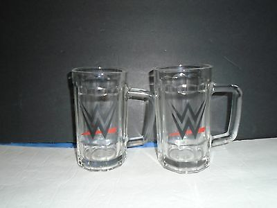 Pair of 2014 WWE Wrestling Beveled Glass Beer Mugs