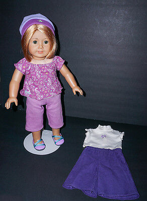 American Girl Doll wearing Tagged Outfit plus Extra tagged outfit