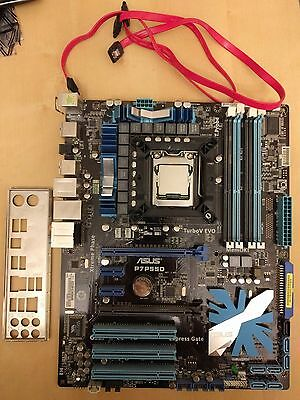 ASUS P7P55D with Intel i5 750 plus SSD, cooler, and wifi adapter