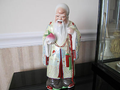 Chinese Man with Apple porcelain figurines