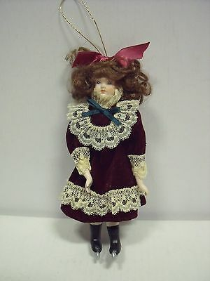 """Antique Bisque Porcelain Doll w/ rope/stick Body: 7"""" with Red Velvet Dress"""