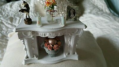 Miniature fireplace display with ornaments included as seen