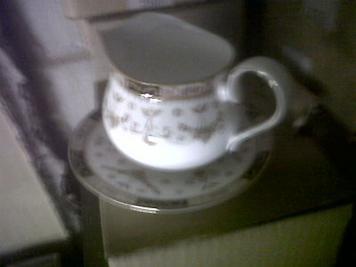 Queens Olde England Gravy Jug and Stand .