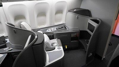 First class flight ticket USA/Canada to/from Asia inc. Singapore and Hong Kong.