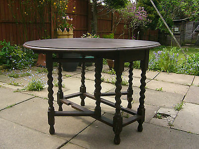 ANTIQUE -  OAK BARLEY TWIST OVAL GATELEG DROP LEAF DINING TABLE - 1920's