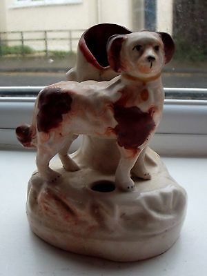 Old Staffordshire pottery dog figure