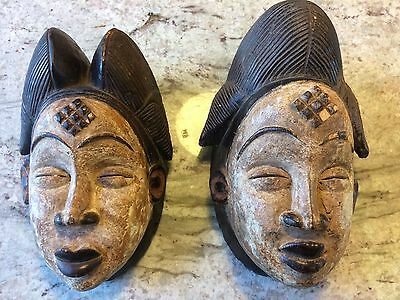 Pair of Authentic Hand Carved African Tribal Masks