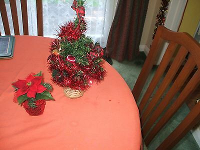 table christmas tree and poinsetta