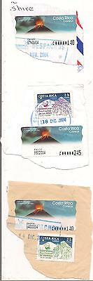 5 COSTA RICA stamps on paper.