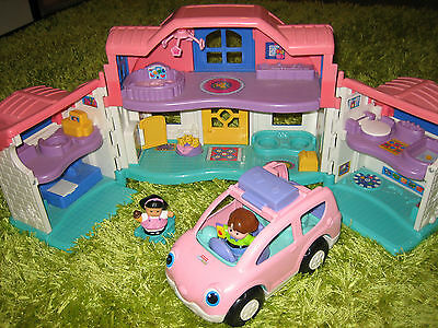 Fisher price little people doll house with a family car