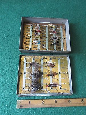 Gut eye salmon fly in fly box brass plates