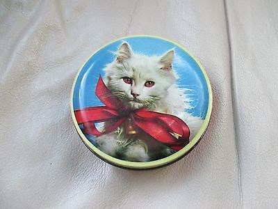 A pretty vintage toffee tin depicting a cute puss cat. George Horner  & Co.