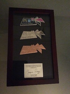 Rare set of london 2012 olympic volunteer pins in presentation frame