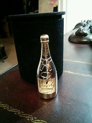 Miniature champagne clock bottle. Gold plated.