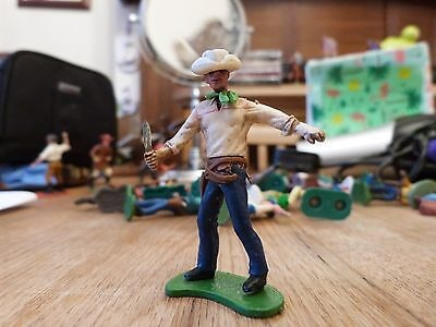 britains swoppet cowboy holding a knife, white hat and shirt, blue trousers