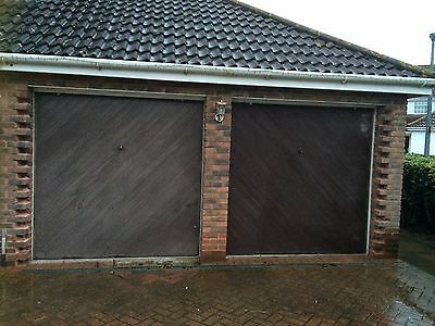 2 large matching garage doors - up and over