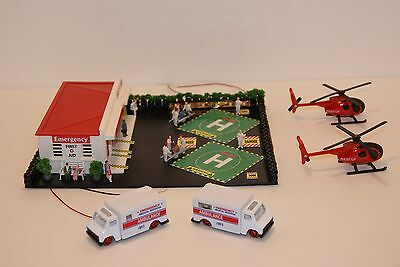 MASSIVE EMERGENCY FIRST AID COMPOUND with 2 HELIPORTS,4 DIECAST UNITS,LIGHTED