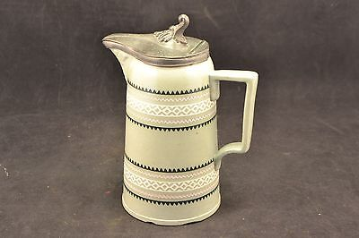 Antique Stoneware syrup pitcher with pewter lid  ND3396