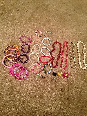 Girls Bundle Of Necklaces Brackets And Rings