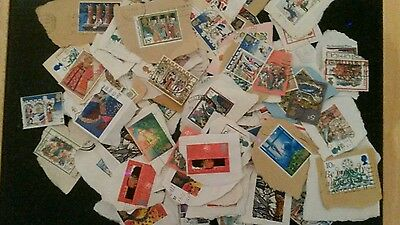 100 + used Great  Britain Christmas  stamps
