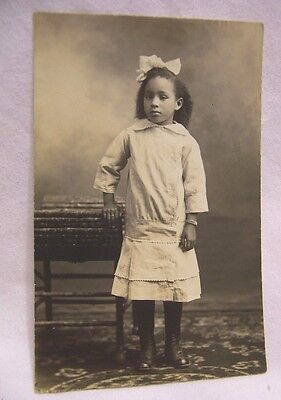 1900's Young Black Girl Dressed Up w/ Bow in Hair RPPC