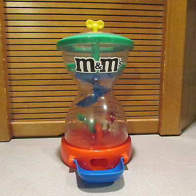 M&M Hourglass Candy Dispenser w/ Red Sitting on Seesaw Action
