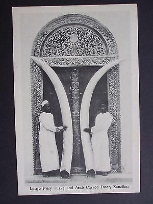 PRINTED PC LARGE IVORY TUSKS AND CARVED DOOR, ZANZIBAR A. C. GOMES EARLY 1900s
