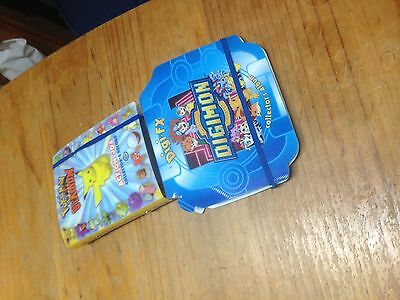 pokemon and digimon books and cards