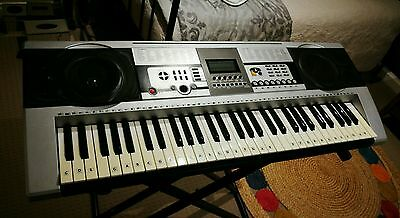 electric keyboard with stand. Used