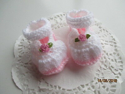 Hand knittted Baby booties/Shoes in pink and white with pink flowers