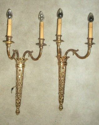 Pair brass finished torchiere style  2 light wall sconces