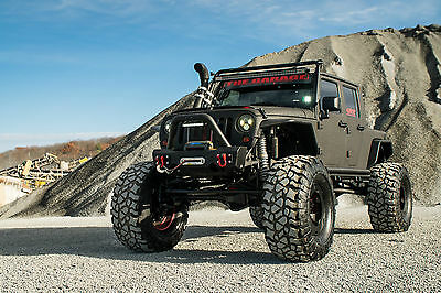 """Jeep: Wrangler 4-DOOR  Project RattleTrap - 07 Jeep JK with a Twin Turbo 12 Valve Cummins on 44"""" Tires"""