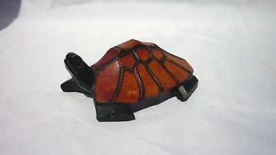Unconventional hand-carved and painted tortoise