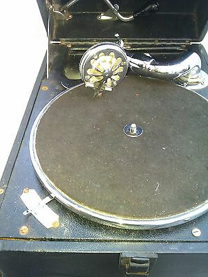 An Hmv Portable Gramophone In Working Order