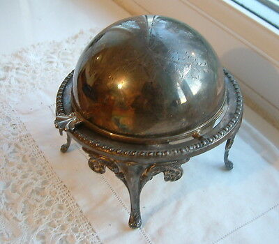 A silver plated roll top butter caviar or bon bon dish with glass liner.
