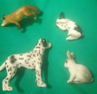 Schmeichel fox dalmatian dog and two rabbits