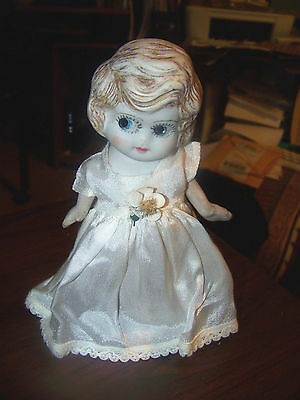 "Googily Eyed 6 3/4"" Made In Japan Bisque Doll Jointed Arms Off White Dress"