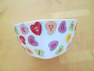 Pottery Heart-Shaped Dish Decorated With Colorful Sweetheart Candies