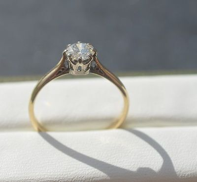 18 kt Yellow and White gold ring with a solitaire diamond of 0.55 ct