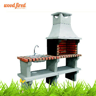 Outdoor brick masonry Mediterranean BBQ with chimney, grill,side table and sink