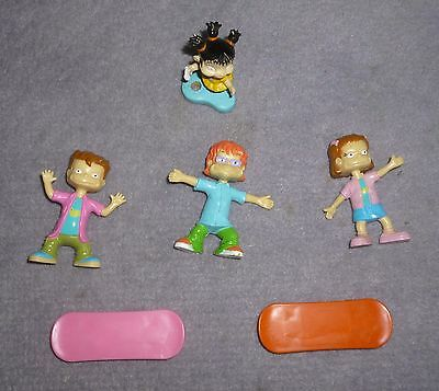 Four Rugrats Viacom Figures plus Skateboards: Kimi, Chuckie, Phil & Lil