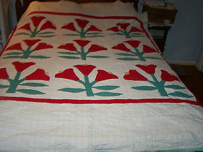 Antique quilt; Primitive; appliqued tulips in bright red w/ green; hand quilted