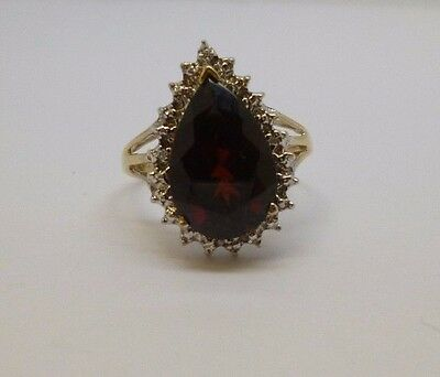 9ct yellow gold pear cut garnet and round cut diamond dress cocktail ring