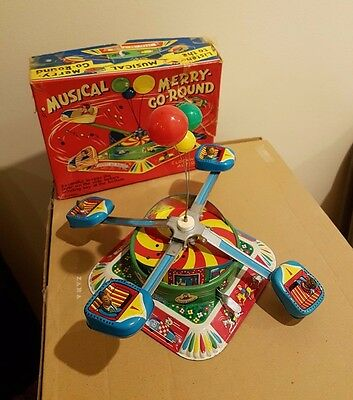 Vintage Alps Musical Merry go round clockwork windup tin toy 1960s, Japan. Boxed