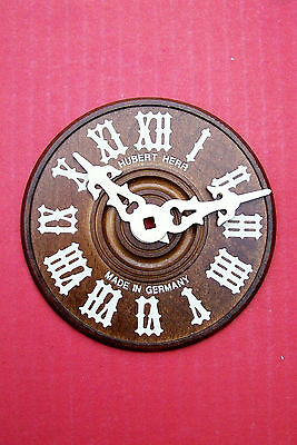 Hubert Herr Black Forest made wood Cuckoo clock dials complete with hands.