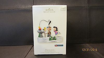 "Peanuts Hallmark Christmas Ornament ""Peanuts on Ice"" Sound and Motion Dated 2008"