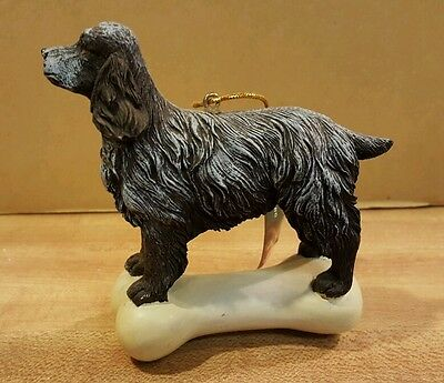 English Cocker Spaniel on a Bone Ornament by  Kurt Adler New with tag