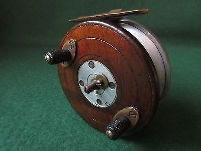 Centrepin Zephyr style wood and alloy with brass starback reel