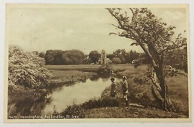 St Ives, Hemingford backwater - picture two School boys by the water & church